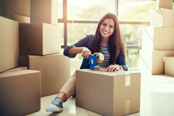 woman checking off packing list