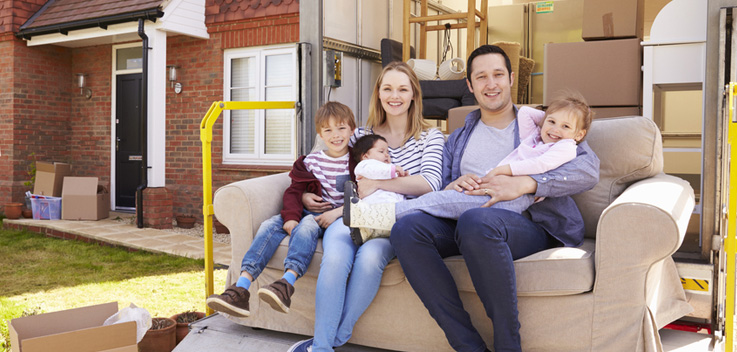 family on couch in moving truck